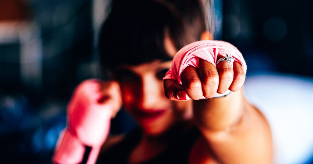 A girl in a boxing gloves
