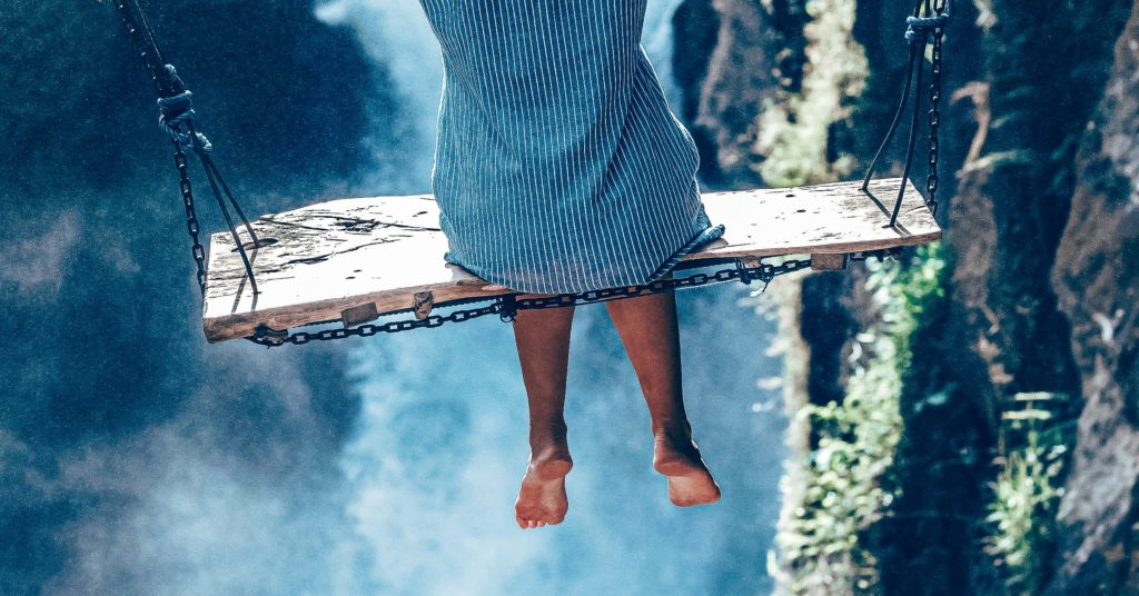 A girl on a swing in the air