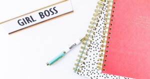 Girl boss sign and notebooks