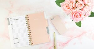 Paper planner and roses